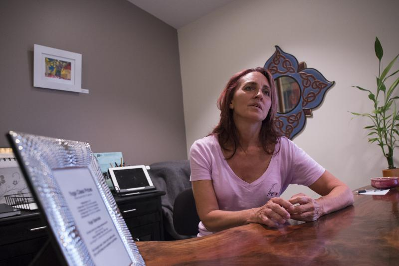 Leslie Gordon of Avon in her yoga studio, a business she started within the last two years.