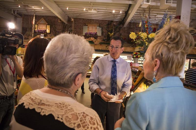 Gov. Malloy stops in Roly Poly Bakery in New Britain.