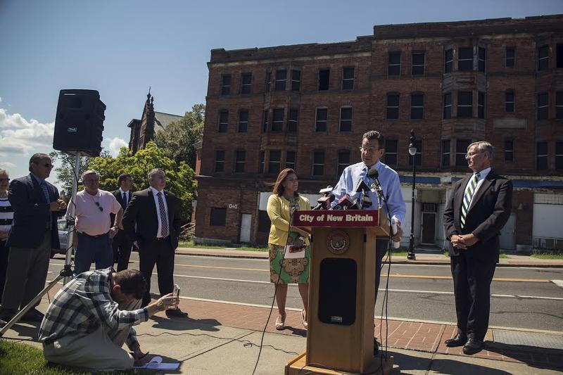 Gov. Dannel Malloy, at podium, with New Britain Mayor Erin Stewart and Department of Transportation Commissioner James Redeker in New Britain on Wednesday.