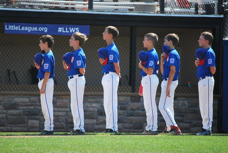 Waterford, Conn., Little Leaguers during the national anthem.
