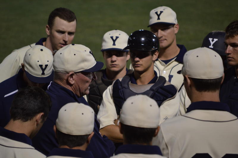 Yale's head coach John Stuper speaks to his team after the loss.