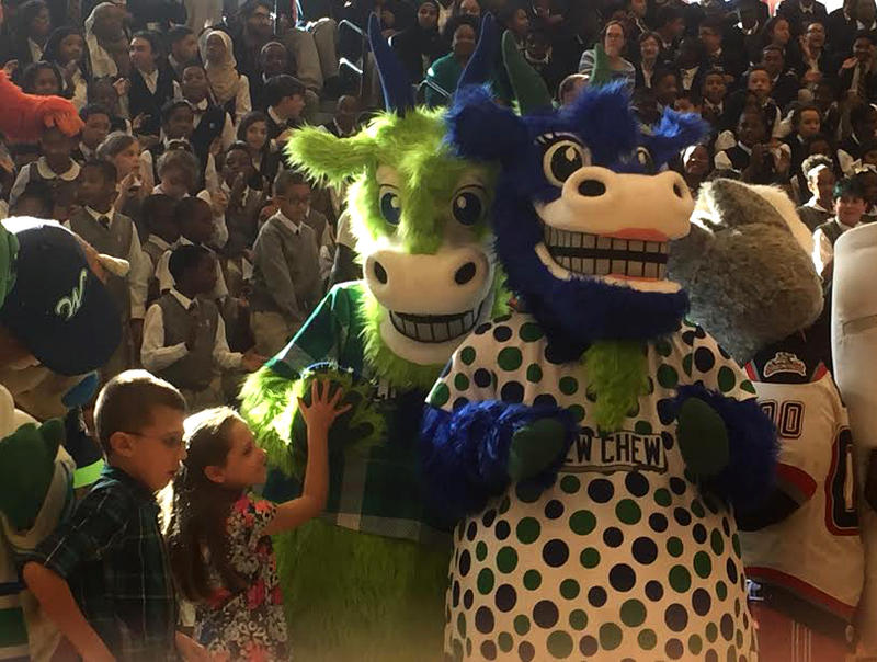 The Yard Goats' new mascots, Chompers and Chew Chew, with mascot-naming contest winners Lauren Konefal and Jeffrey Boyle.