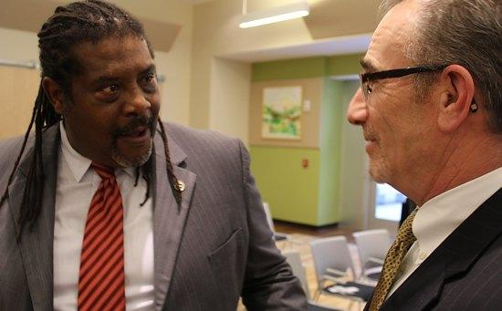 Retired New Haven detective Stacy Spell, at left, local Project Longevity chief, with Assistant U.S. Attorney Peter Markle at a Project Longevity call-in earlier this year.