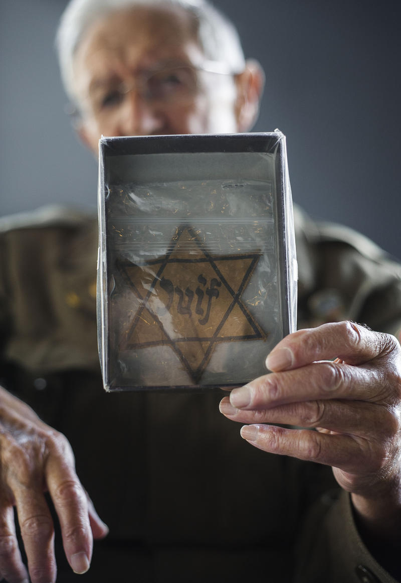 Ben Cooper shows a Star of David that was given to him by a Frenchman who lived in France when Adolf Hitler took over.