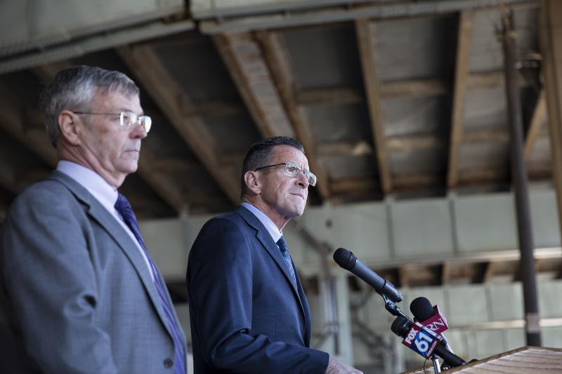 Gov. Malloy speaks at a press conference under the I-84 viaduct in Hartford.