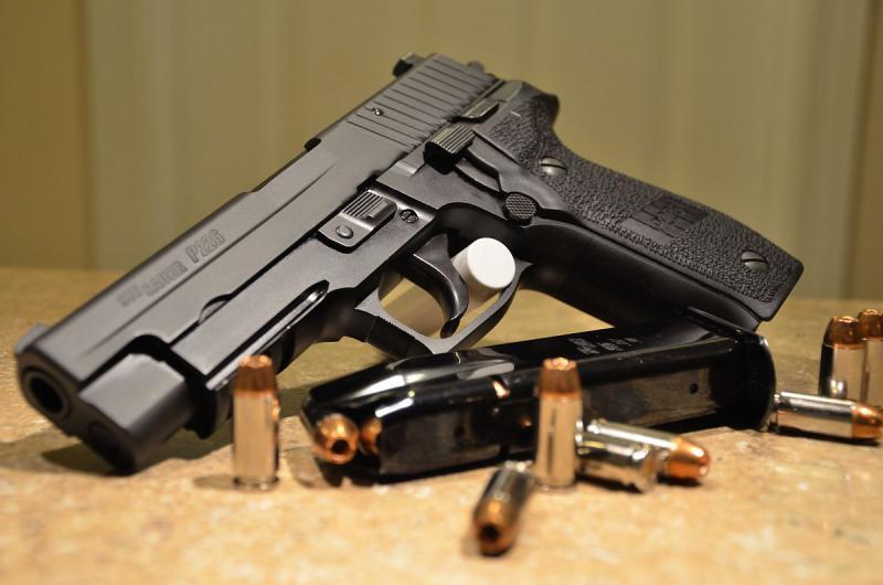 A Sig Sauer M11 handgun.