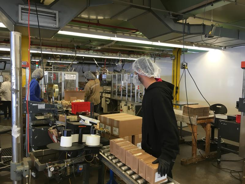 Employees pack toothpaste at Sheffield Pharmaceuticals in New London.