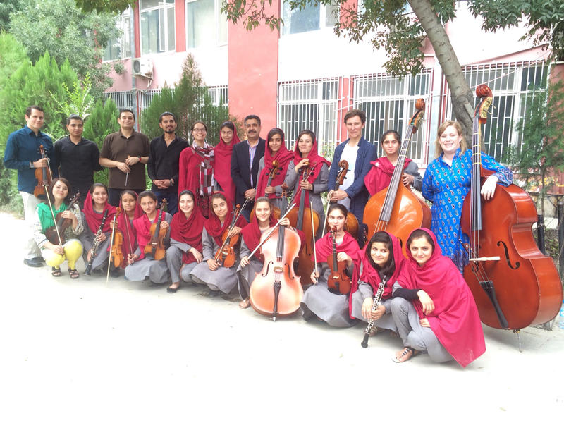 Members of Hartford-based Cuatro Puntos and Kabul's all-girl Ensemble Zohra outside The Afghanistan National Institute of Music last summer.