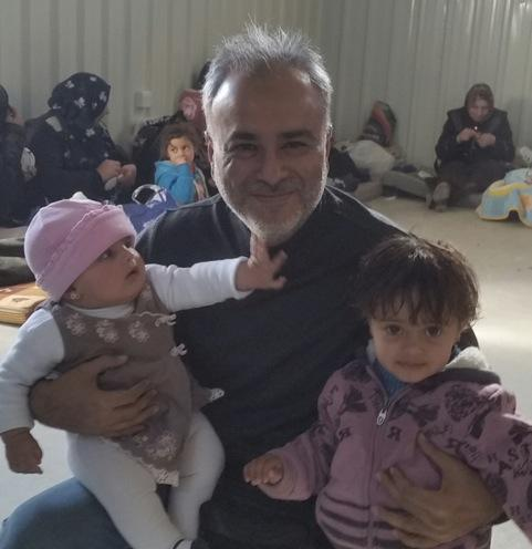 Saud Anwar with Syrian refugees in Jordan.