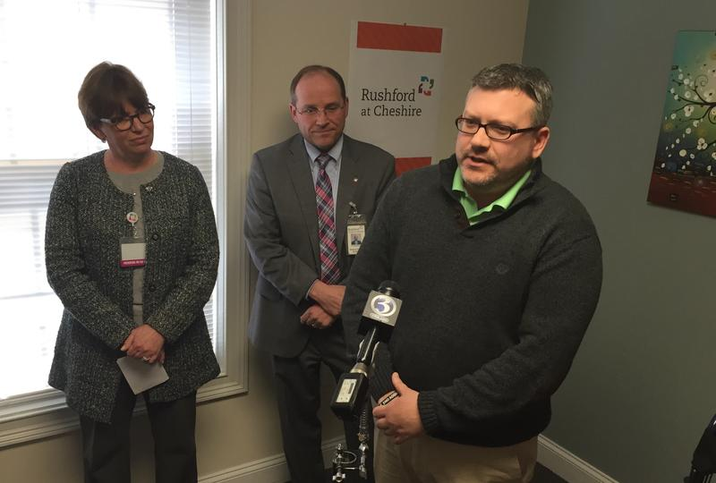 Michael Mitchell (center) speaks about his battle with addiction, joined by HartfordHealthcare's Pat Rehmer (left) and Dr. J. Craig Allen.