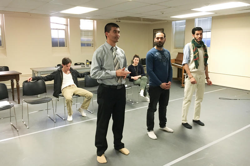 "Cast members of ""Voices From the Long War"" practice. Ali Al Saadi, an Iraqi refugee, is in the middle."