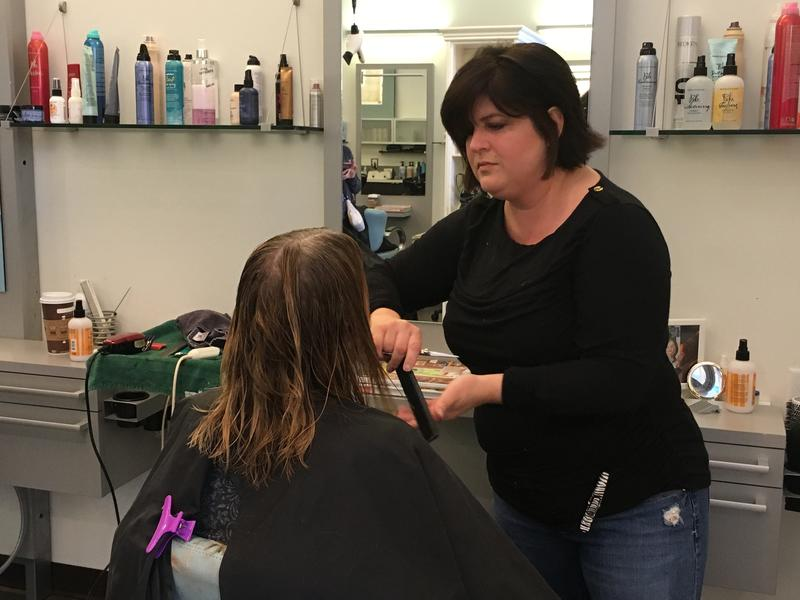 Melissa Hume cuts a client's hair during her Hair for Healing event.