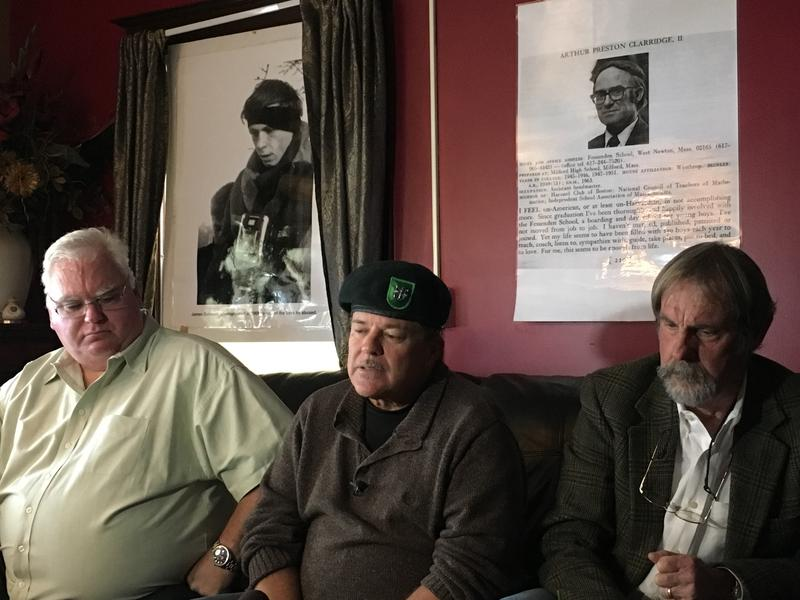 John Sweeney, center, with Adrian Hooper, right and John Parker. Above them are pictures of some of the men that they say perpetrated abuse at Fessenden.