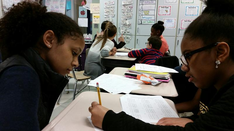 Hannah Alexander helps Brianna Jones with math questions as part of the Jones Zimmerman Academic Mentorship Program.