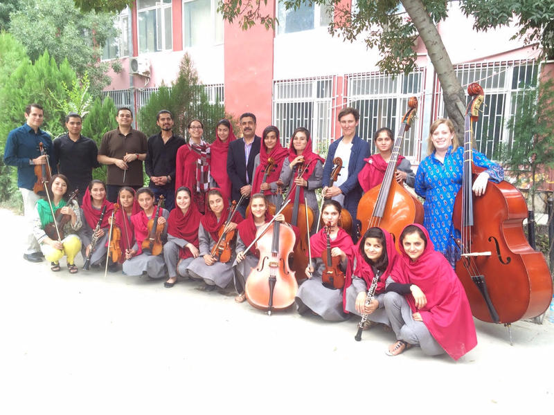 Kevin and Holly Bishop, on opposite ends of the group, with the girls of the Afghanistan National Institute of Music and others.