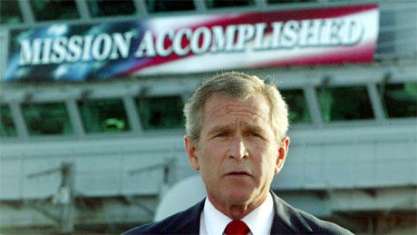 George W. Bush with his Mission Accomplished banner.