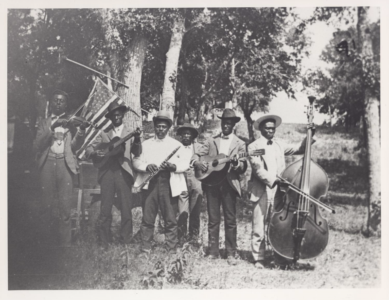 "Photograph of African-American band at Emancipation Day celebration, June 19, 1900, held in ""East Woods"" on East 24th Street in Austin."