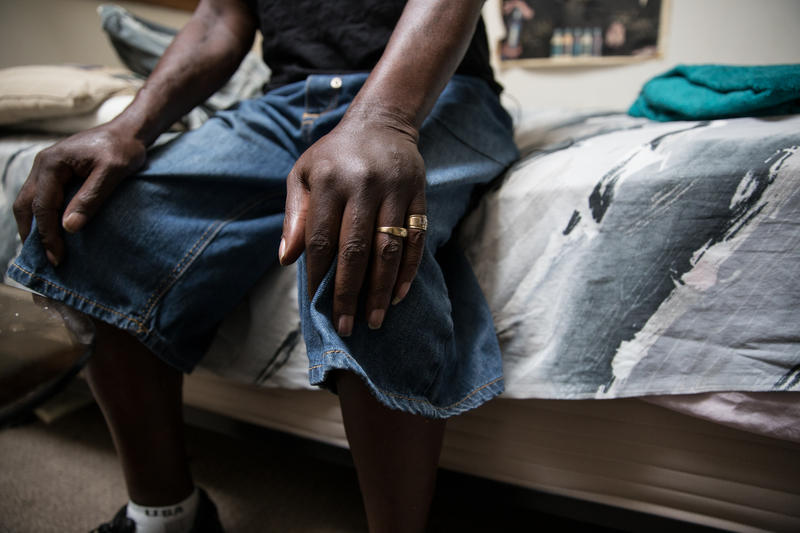 Sherwood Taylor sits on his bed. He reversed an overdose in his apartment using naloxone he got from Mark Jenkins of the Greater Hartford Harm Reduction Coalition.