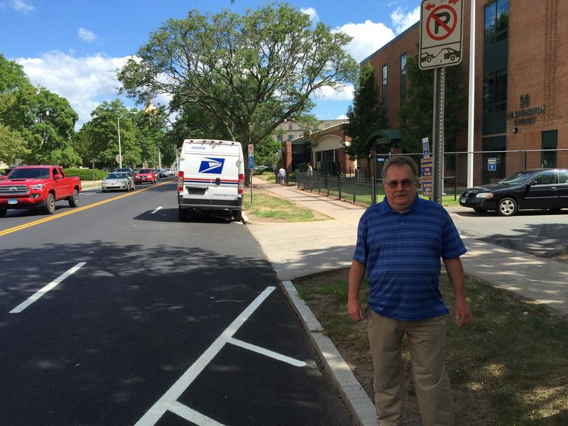 Marshal George Soucie stands near where he got the parking ticket in question.
