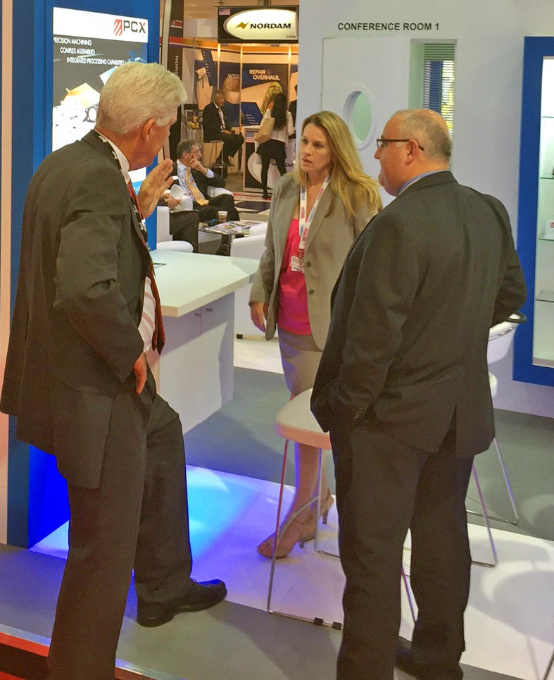 PCX Aerostructure's Kathy Morin and Trevor Hartman, right, talk with a customer at the Connecticut Pavilion during this month's Farnborough International Airshow in England.