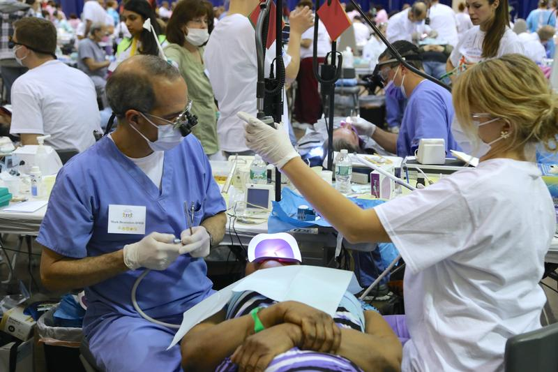 Volunteers and patients at the 2014 Mission of Mercy dental clinic at Hartford's XL Center.