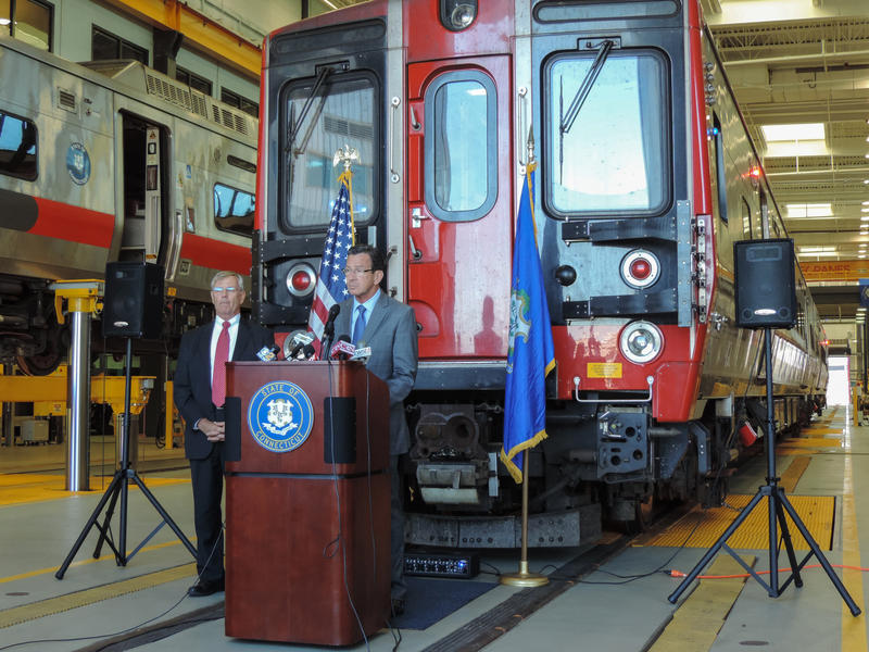 Gov. Dannel Malloy announces the addition of a new fleet of M-8 cars to the New Haven Line at a press conference Tuesday.
