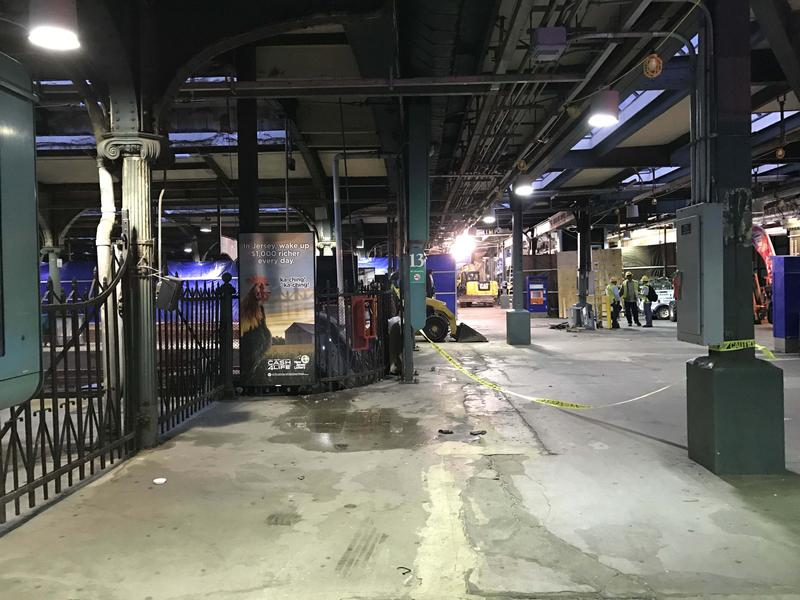 Workers continue to clean up two days after a train crashed into the Hoboken Terminal in New Jersey.