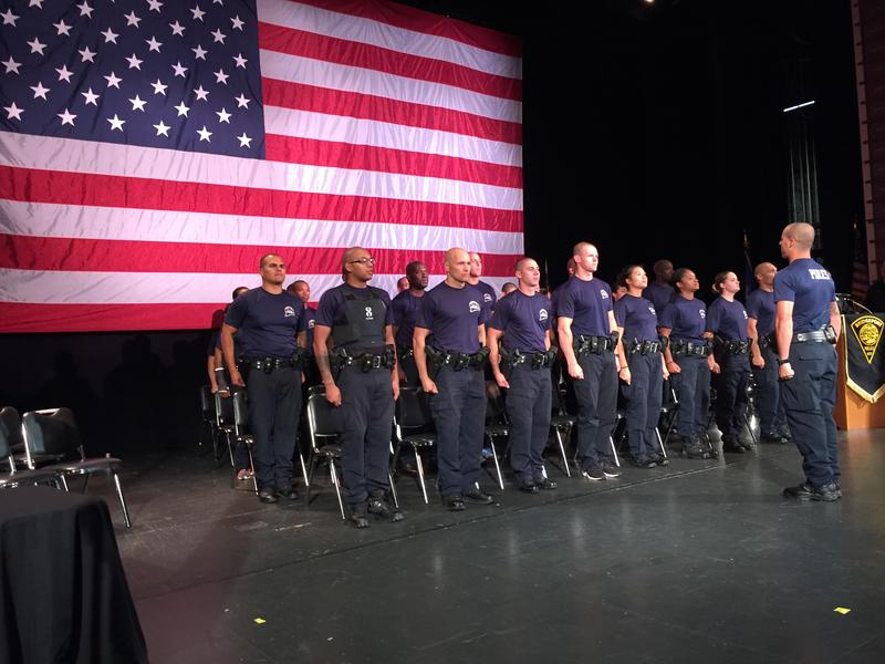 Members of Bridgeport's 37th police class rehearse before graduation.