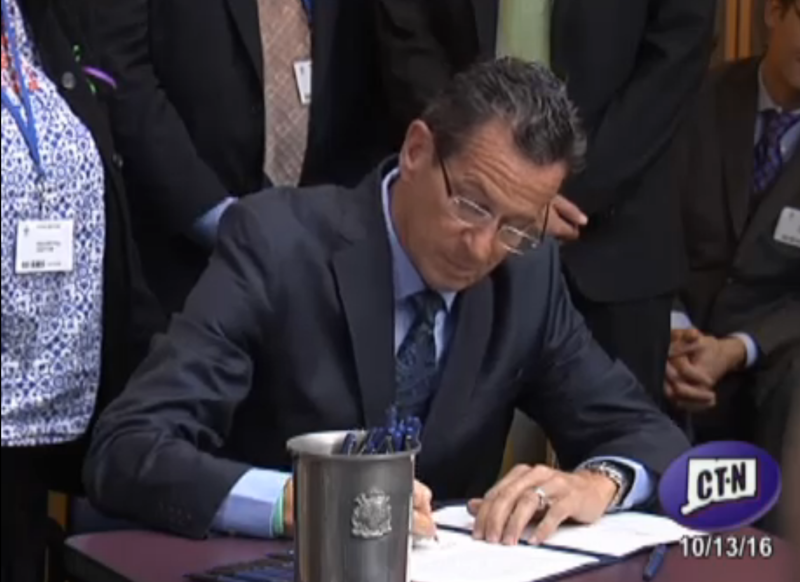 Governor Dannel Malloy signs the legislation