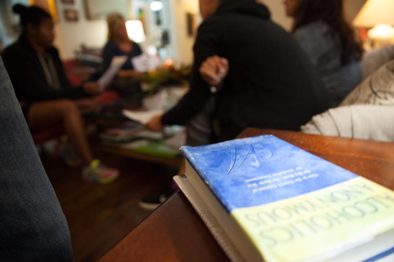 Residents of Right Path House in Clinton, Connecticut meet with their recovery coach in the home's living room -- one of the many services the sober living house provides.