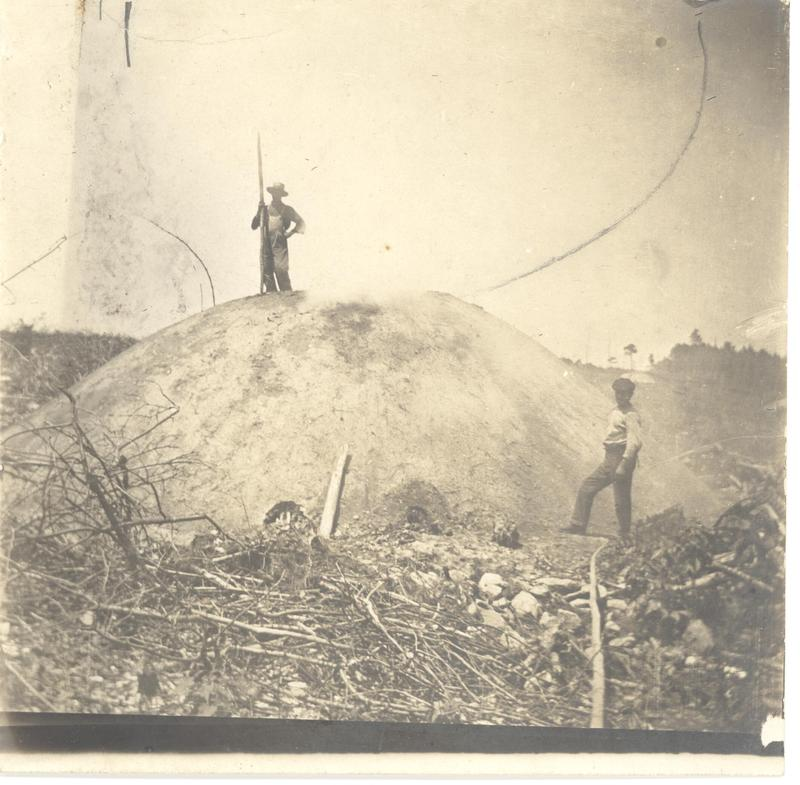 Colliers would build a ladder on one side of the mound to access upper portions. When jumping the pit, some colliers would hold their shovels parallel to the ground. That way, in case they fell into the hole -- the pole would, hopefully, catch.
