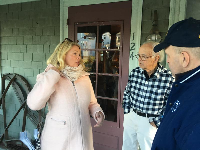 Heather Somers talks to voter Peter Barlow, while Stonington Selectman Mike Spellman, a registered unaffiliated voter looks on.