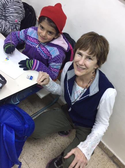 Melissa Croghan with a refugee child in Jordan