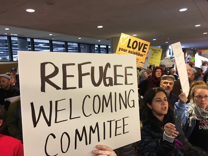 Protestors gather at Bradley International Airport on Sunday afternoon.