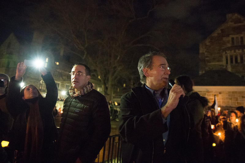 IRIS Executive Director Chris George speaks at a candlelight vigil in New Haven on Sunday night. He says one Syrian family of five made it to Connecticut less than a day before President Donald Trump's order barring Syrian refugees from the United States.