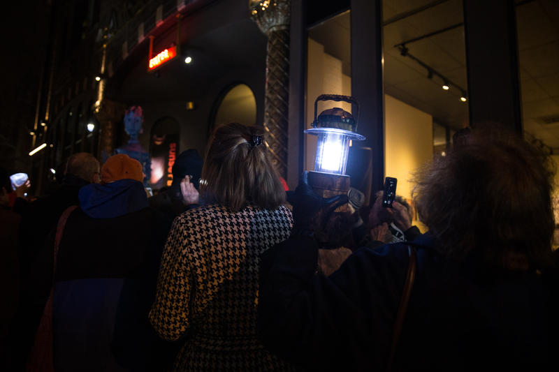 People gathered in front of theaters across Connecticut to shine flashlights, lamps, and cell phone lights on Thursday.