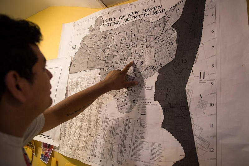 "Immigration rights activist Jesus Sanchez looks at a map of New Haven, one of Connecticut's ""sanctuary cities."""