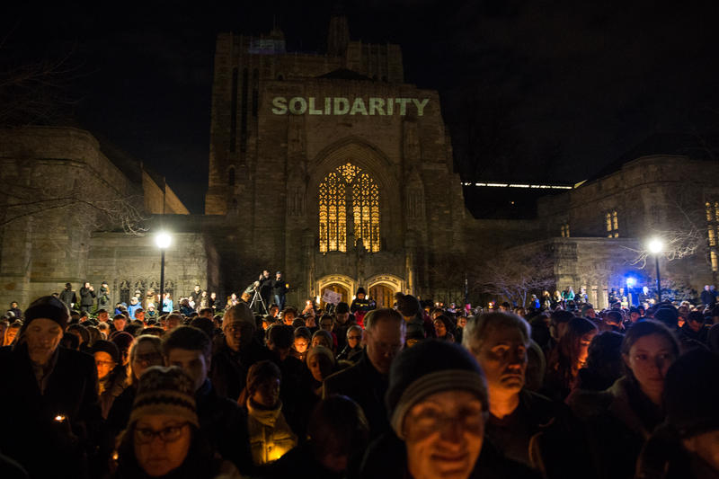 Crowds gathered in New Haven Sunday night at a candlelight vigil held in support of the immigrant and refugee communities.