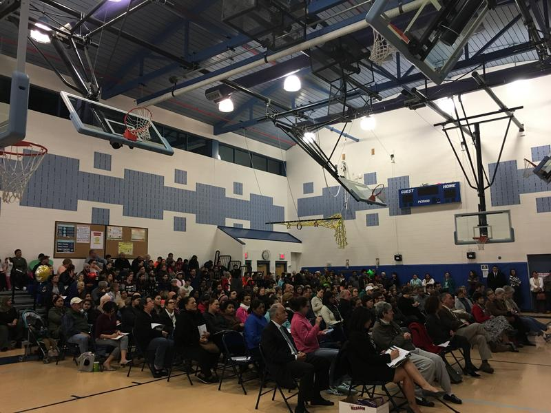 The audience at CB Jennings Elementary listens to a presentation on the rights of undocumented immigrants.