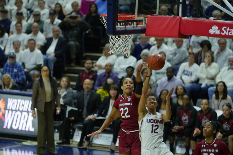 UConn's Saniya Chong is contested at the basket by South Carolina junior A'ja Wilson during Monday's game in Storrs.