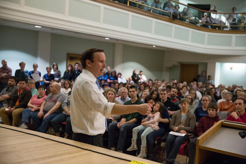 Murphy answers questions from the audience at a town hall meeting in West Hartford.
