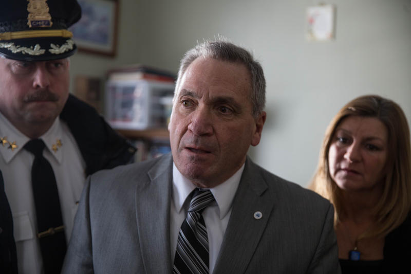 New London Mayor Michael Passero stands with Chief of Police Peter Reichard and Lisa Johns of Community Speaks Out in a state-funded addiction recovery home in New London, Connecticut.