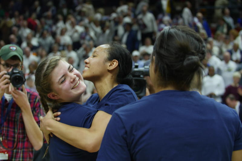 Senior Saniya Chong (right) hugs freshman Kyla Irwin (left) after the Huskies beat South Carolina, Monday.