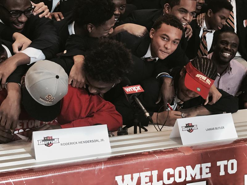 Capitol Prep-Hartford teammates rush Roderick Henderson and Lamar Butler during their ceremony. The defensive duo will move on to Seton Hill College in Pennsylvania.