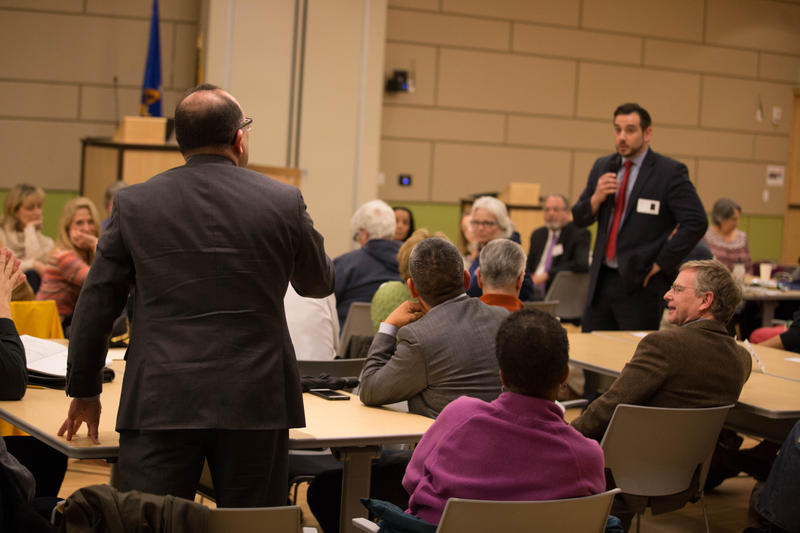 """A forum participant speaks with Connecticut Republican Party Chairman J.R. Romano  during a discussion hosted by WNPR and WSHU at Gateway Community College in New Haven about the concept of """"sanctuary."""""""