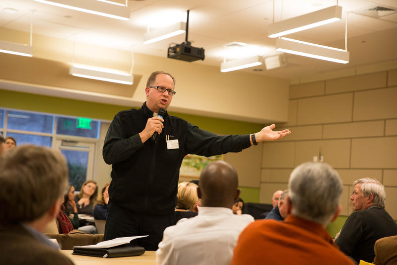 Father James Manship speaks during the forum.