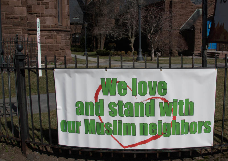 A banner in front of Asylum Hill Congregational Church. The Trump administration's reissued travel ban on six majority Muslim countires is set to go into effect March 16.