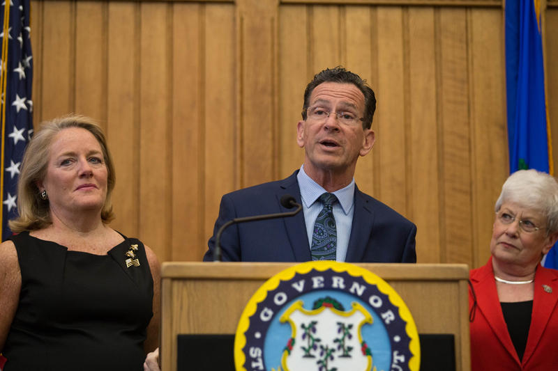 Gov. Malloy speaks at a press conference on April 13, 2017. To his left is his wife, Cathy Malloy, and to his right is Lt. Gov. Nancy Wyman.