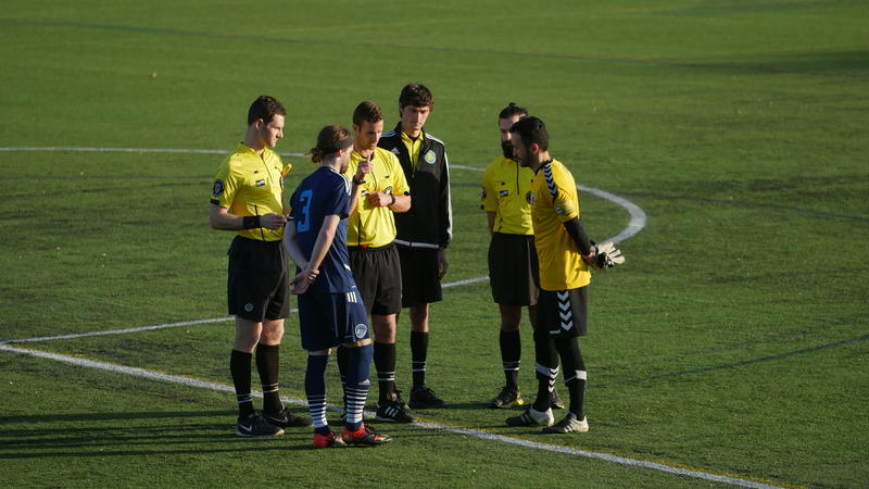 "Each team's captains meet with the officials before the inaugural ""I-91 Derby""."