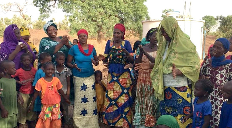 Women in Gouloumbou village in Senegal sing in appreciation of efforts to build a rural community radio station near Tambacounda. The village of farmers donated land atop a hill for the project.